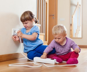 Two children  playing with electrical extension